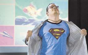 Cartoonist Jason Kotecki reveals his Superman within during a talk Sunday at St. Anthonys Church in Portsmouth. He recalled how having a Superman T-shirt made him think as a boy that he really was the comic-book hero. Jason Kotecki is Superman. (Megan Rathfon/Daily News staff)